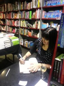 Signing books (with wine)
